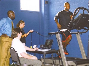 Zig Ziegler and staff conduct a biomechanics assessment on the running mechanics of Anquan Boldin