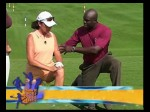 Zig Ziegler assist a female golfer with a static stretch recommend from her 3D Swing Analysis.